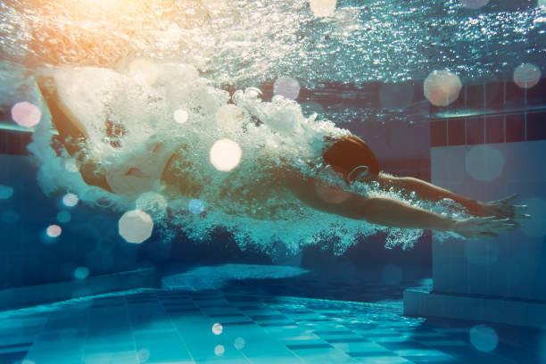 Men under water stock photo