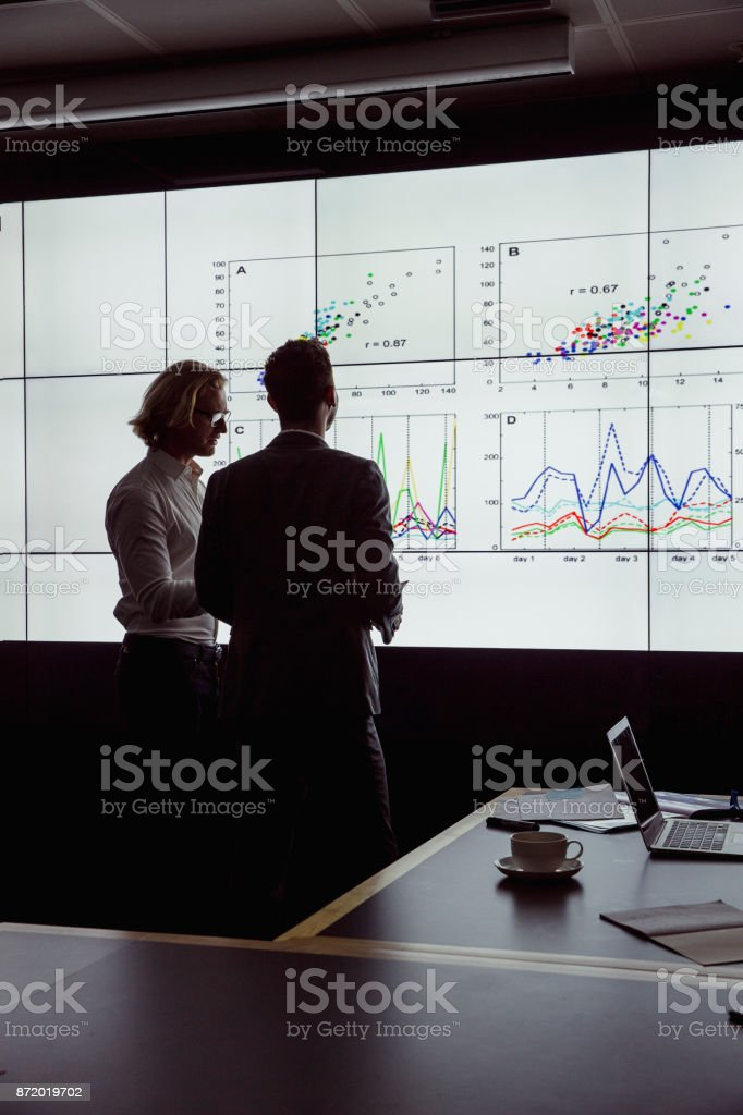 Men Viewing an Oversized Computer Screen stock photo