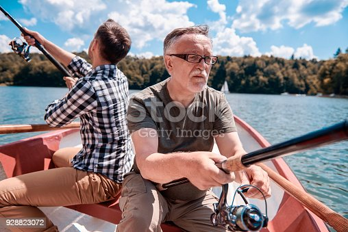 483319252 istock photo Men waiting for fish and bite 928823072