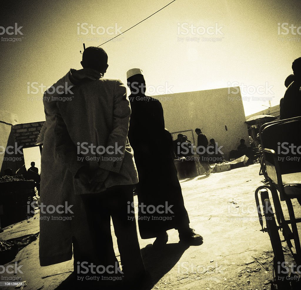 Men Walking Around Marketplace in Northen Africa royalty-free stock photo
