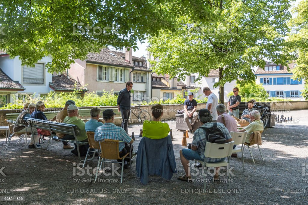 Men watch street chess game in Zurich stock photo