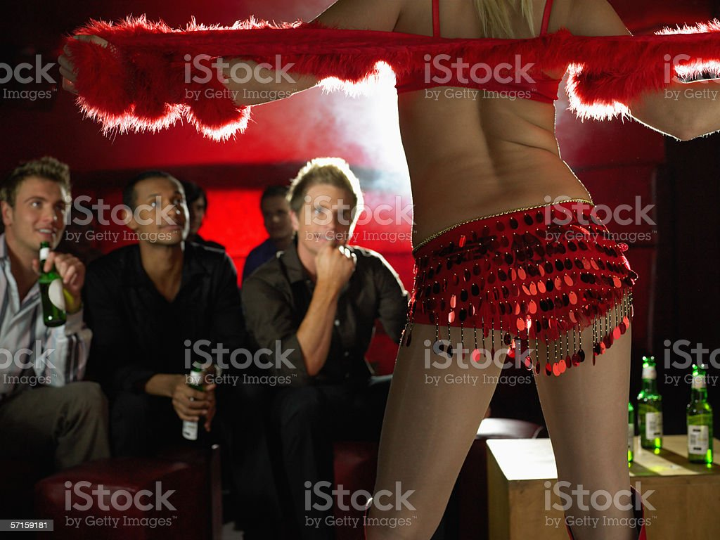 Men watching strip tease stock photo