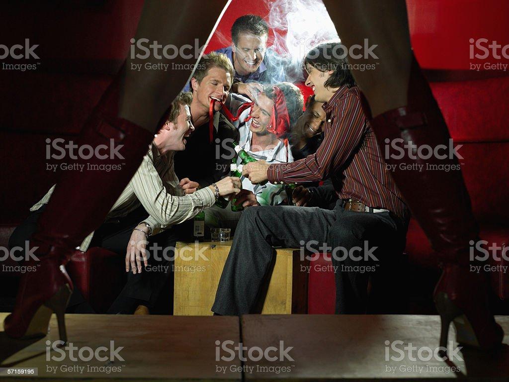 Men watching strip tease royalty-free stock photo