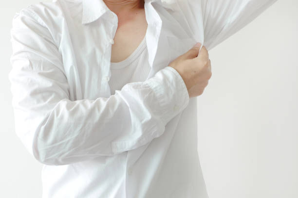 Men wear white sleeves, arms are covered with armpits, they are unclean and unclean. stock photo
