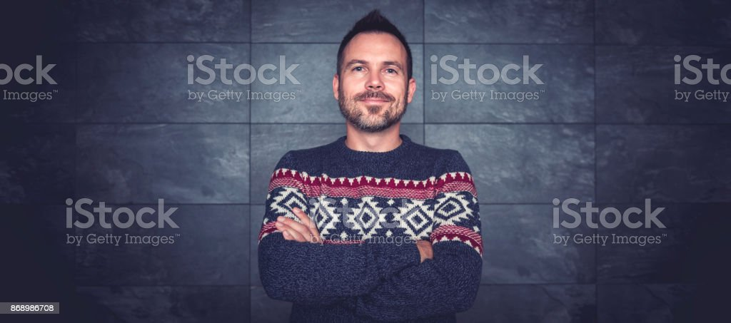 Men wearing blue sweater and eyeglasses posing stock photo