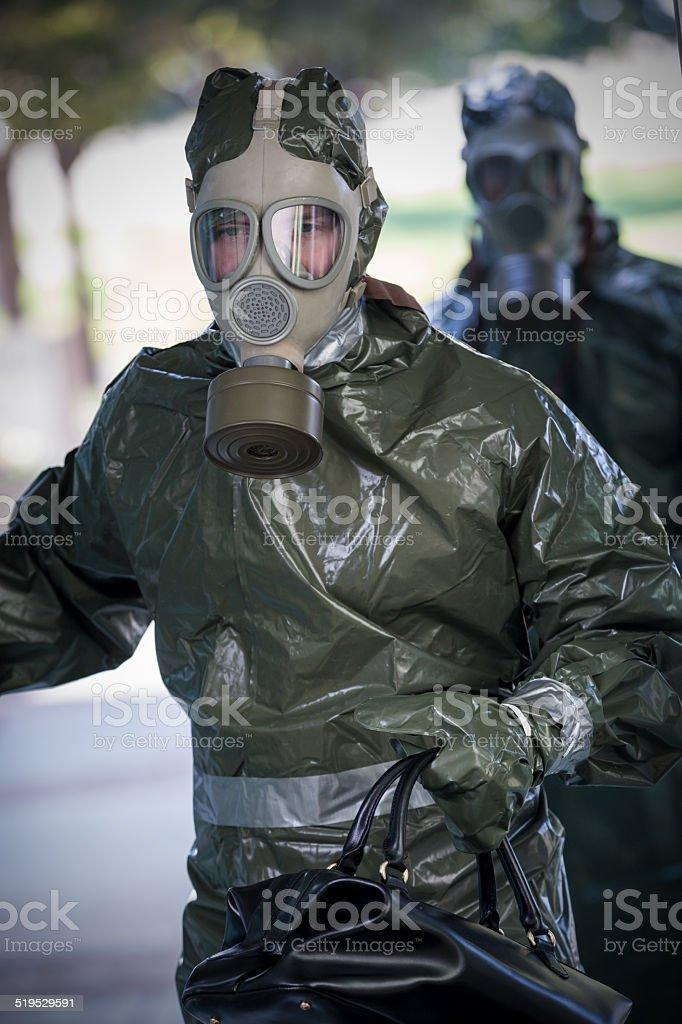 Men Wearing Hazmat Suits And Gas Masks Entering Office Building
