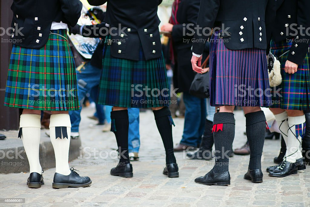 Men wearing kilts during a ceremony stock photo