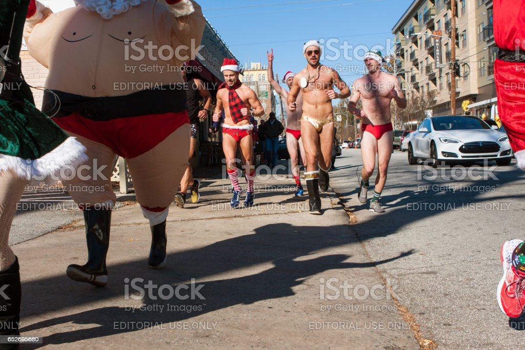 Men Wearing Speedos Run In Bizarre Atlanta Fundraiser Event stock photo