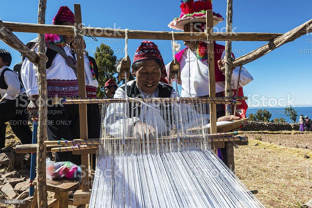 men weaving in the peruvian Andes at Puno Peru stock photo