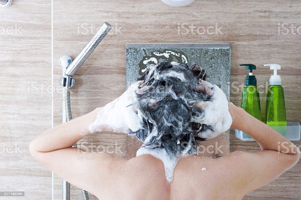 Men who wash the head in the bath stock photo