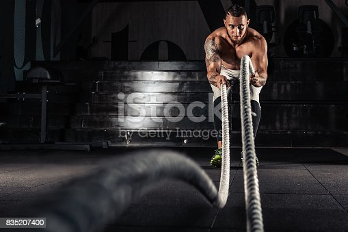 istock Men with battle ropes exercise 835207400