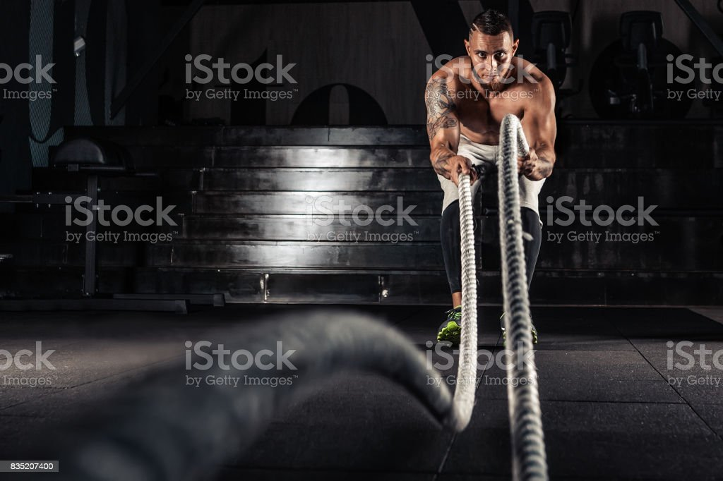 Men with battle ropes exercise stock photo