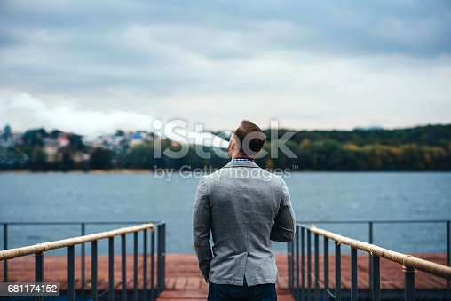 istock Men with beard smoking electronic cigarette outdoor 681174152