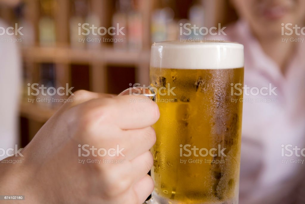Men with beer in hand royalty-free stock photo