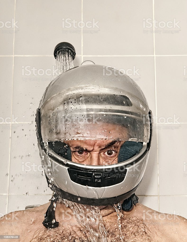 Men with helmet in shower. royalty-free stock photo