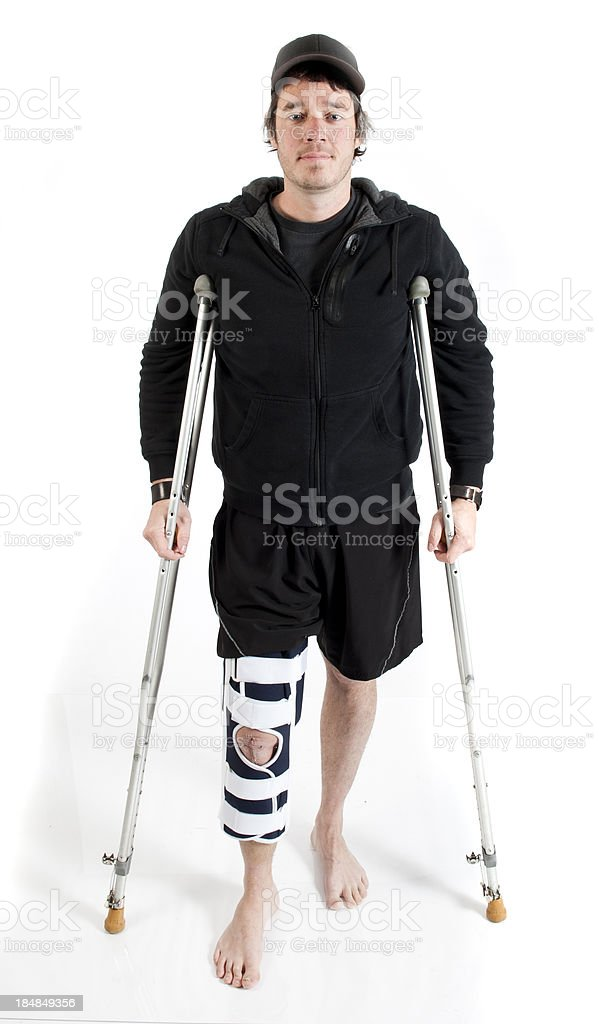 men with knee brace standing up after medical surgery stock photo