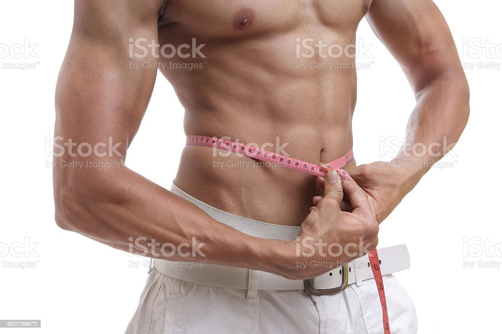Men With Perfect Abs Measuring His Waist Stock Photo