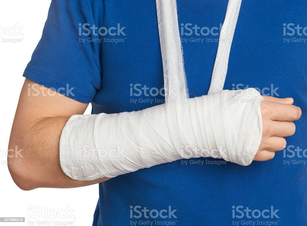 Men with plastered hand on white background stock photo