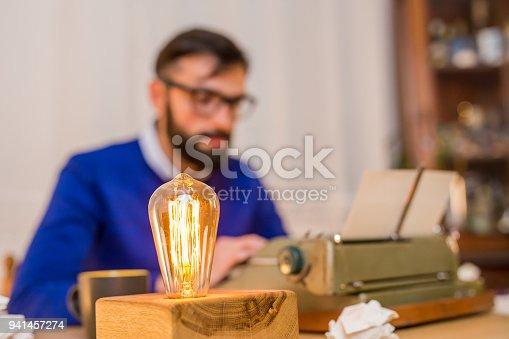 istock Men with retro typewriter 941457274