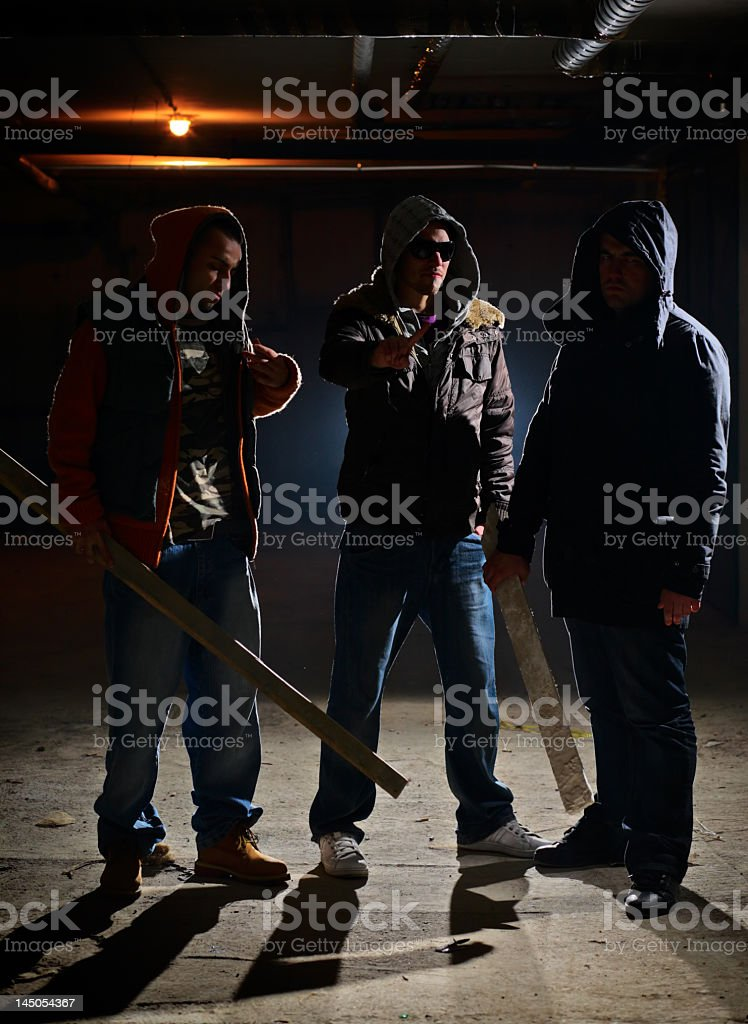 Men with wooden sticks in their hands are ready for a fight stock photo