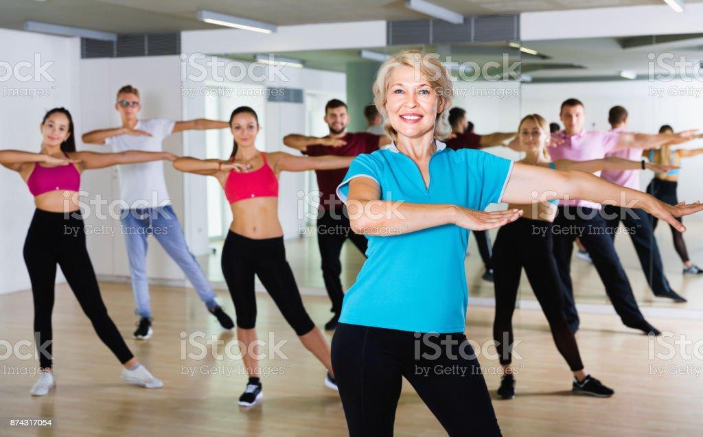 Men women performing modern dance in fitness studio stock photo