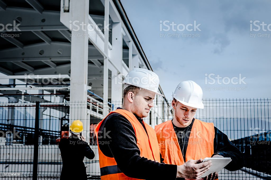 Men working at a building site stock photo