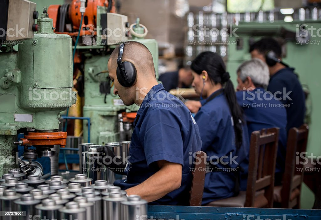 Men working at a factory stock photo