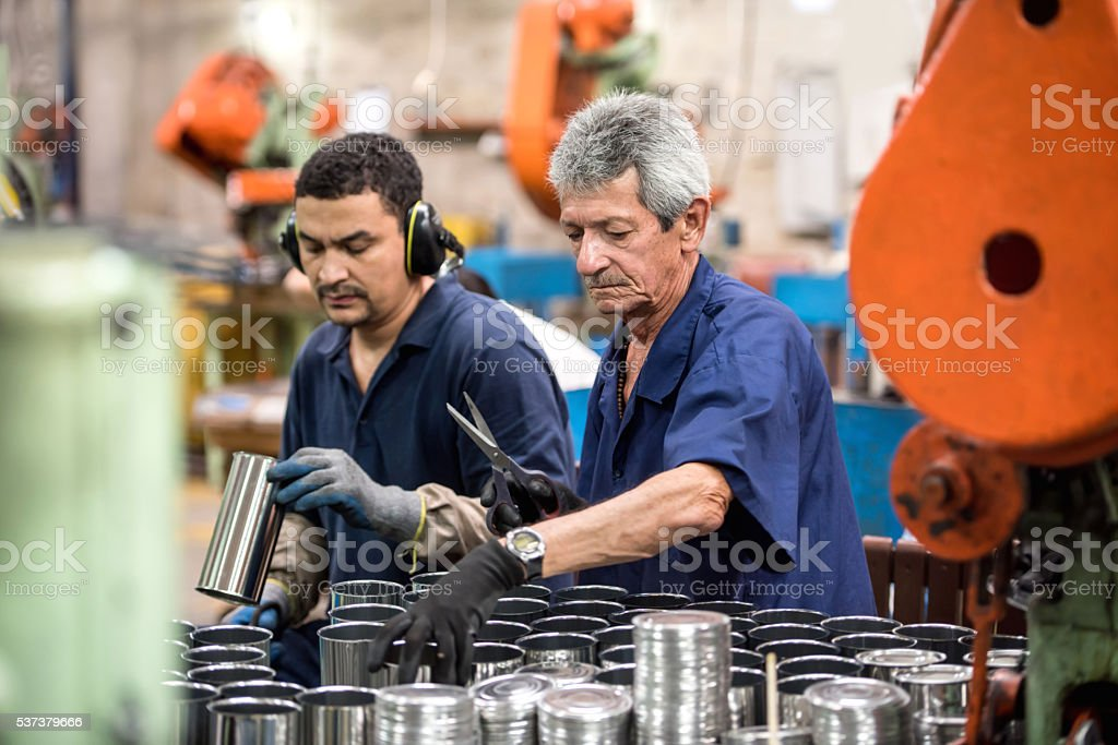 Men working at a metal factory stock photo