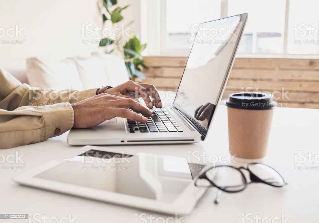 Men working at home. Freelancer businessman using laptop Business man typing on laptop computer Adult Stock Photo