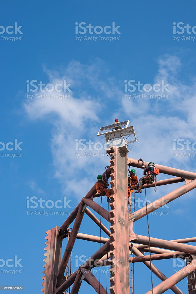 Men working at oil and gas rig leg stock photo