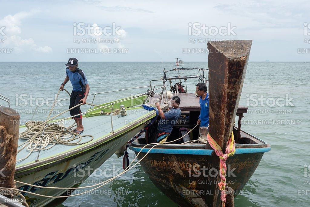 Men working in boats at Ao Nammao pier royalty-free stock photo