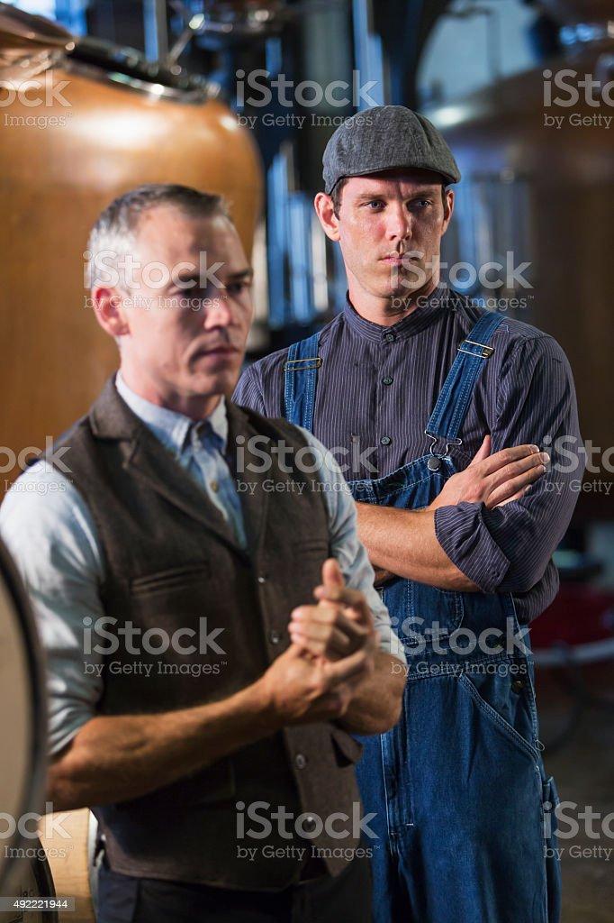 Men working in old distillery stock photo
