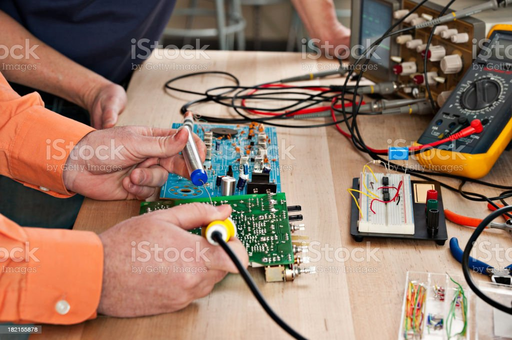 Men working on Circuit Boards royalty-free stock photo