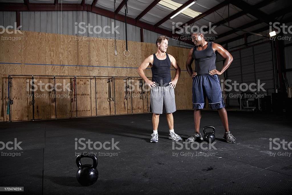 Men working out with kettle bell stock photo