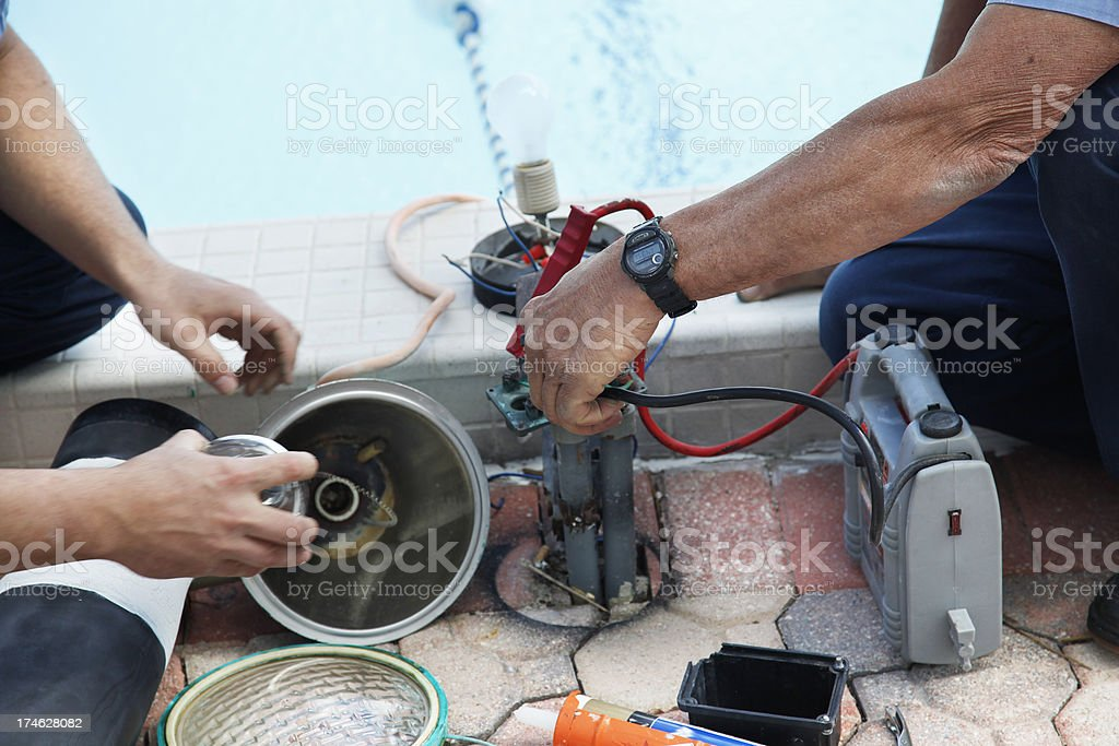 Men working together stock photo