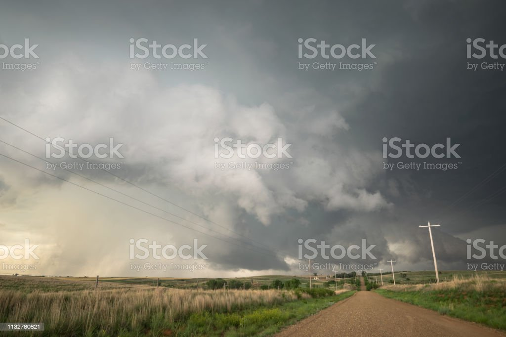 This storm produced large hail and a brief tornado. Photographed...
