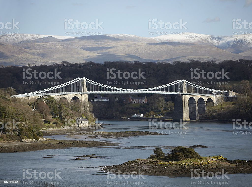 Menai Bridge, Anglesey, with Snowdonia, North Wales  Anglesey - Wales Stock Photo