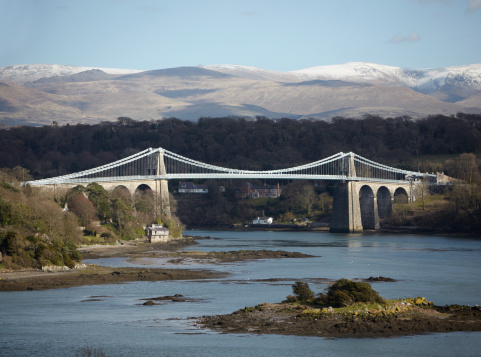 Menai Bridge Anglesey With Snowdonia North Wales Stock Photo - Download Image Now