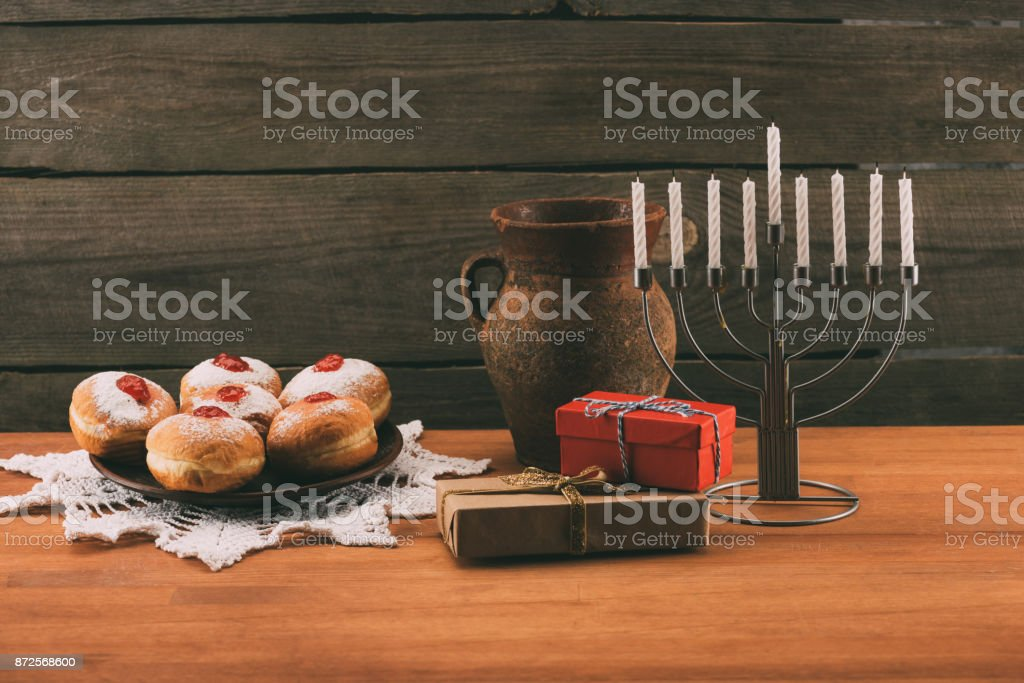 menorah, gifts and donuts for hanukkah stock photo