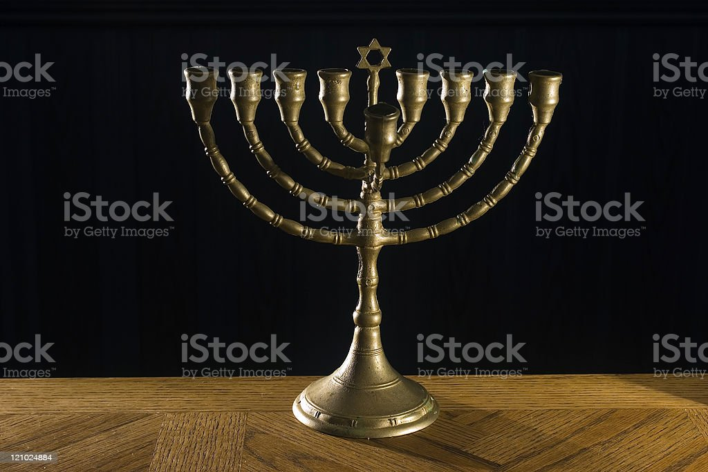 Menorah on table with black background stock photo