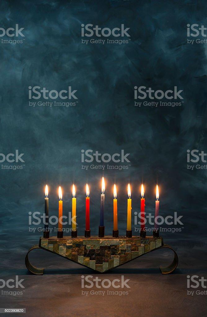 Menorah with burning candles for Hanukkah stock photo