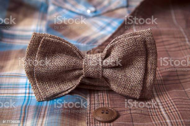 Mens accessories bow tie wedding rings on textile background picture id917726538?b=1&k=6&m=917726538&s=612x612&h=jh6haksc4ggcb n25diszjxnvnaquiqnsw36b624xgo=