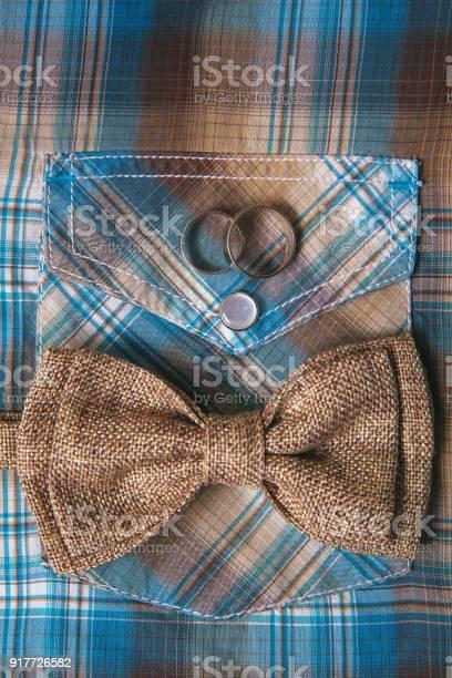 Mens accessories bow tie wedding rings on textile background picture id917726582?b=1&k=6&m=917726582&s=612x612&h=zreljs4hluugez9awrabjmlmndgyqsylhcxwxxi8noy=