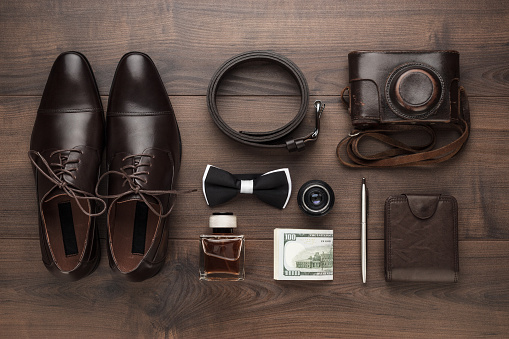 men's accessories in order on the brown wooden table overhead view