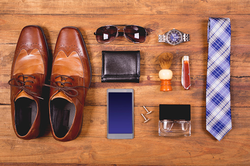 Men's accessories organized on table in knolling arrangement stock photo