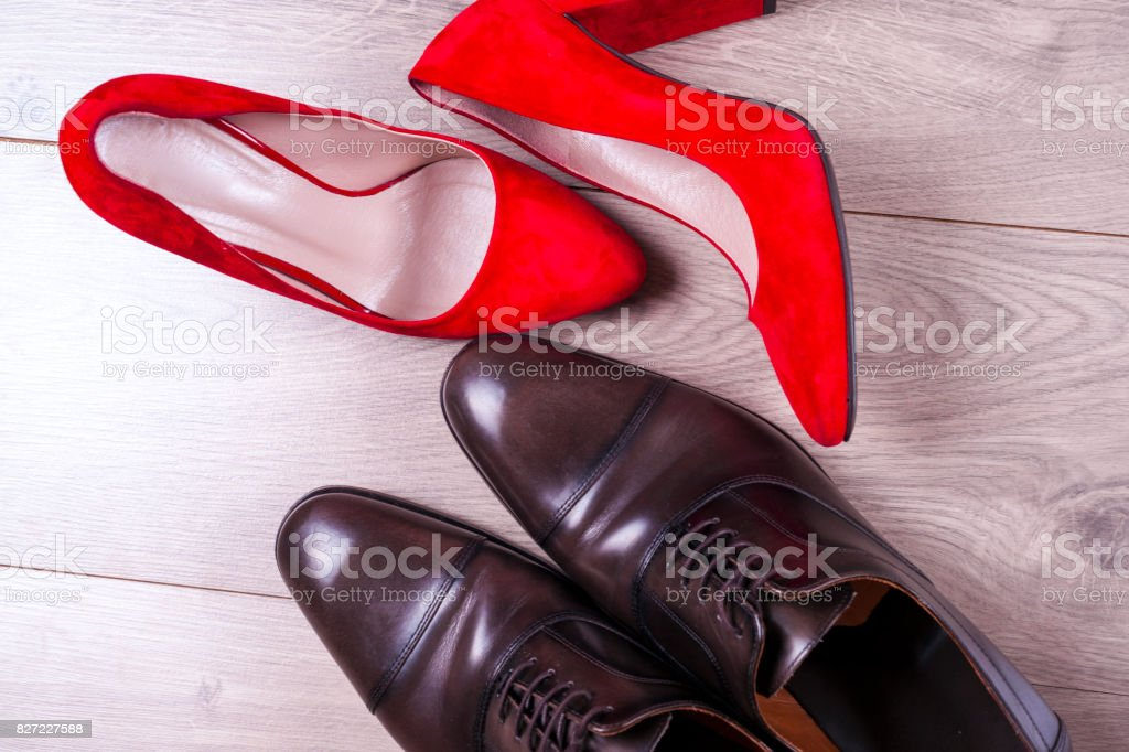men's and red high heel womens shoes on white background stock photo