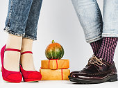istock Men's and women's legs, bright socks. Close-up 1150804766