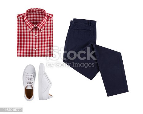 Flat lay set of classic men clothes such as red shirt, blue trousers and white shoes on white background. Top view.