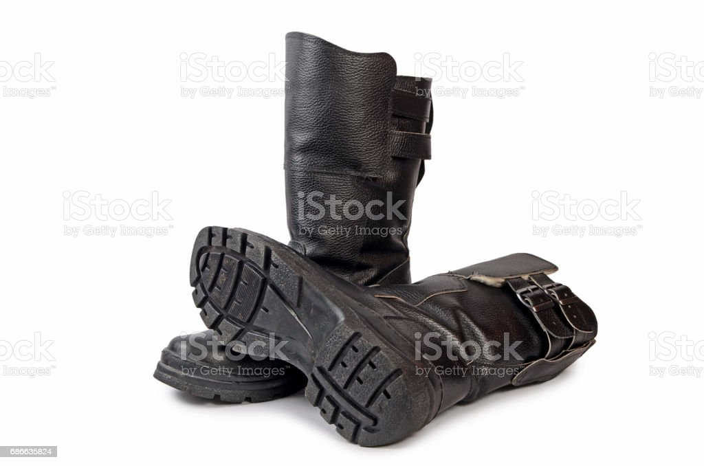 Mens black boots on white background royalty-free stock photo