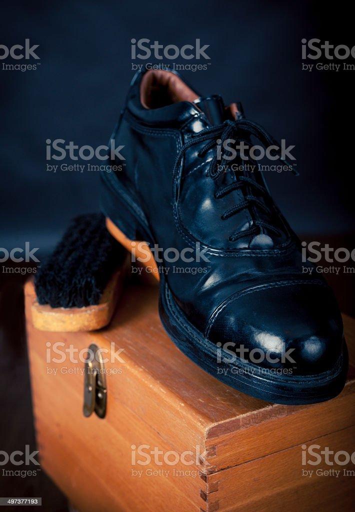 Men's Black leather Dress Shoe On Old Shoeshine Box stock photo